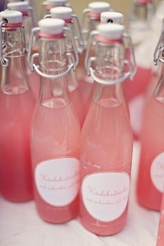 Pink drinks (think pink lemonade!) in vintage style containers make a sweet favor idea for bridal showers or  a bachelorette party.