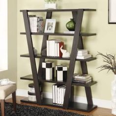 Inverted supports at the front and back of this bookcase give it a unique look to enhance your modern decor while adding useful storage. This contemporary bookshelf in a rich cappuccino finish is a stylish way to increase storage space in any room in your home.