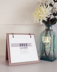 2013 Mini Desk Calendar with stand on natural recycle brown paper with cotton twine. Features monthly Islamic reminders. $20.00, via Etsy.