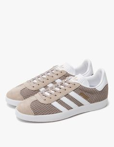 From Adidas, a classic low top sneaker in Vapour Grey and White. Lace-up front with flat woven laces. Engineered knit upper with mesh vamp and quarter. Lightly padded collar. Pigskin suede eyestay and toe cap. '3-Stripes' branding at lateral and medial si