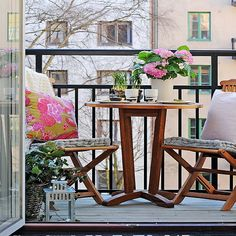 Small wooden table with matching chairs.