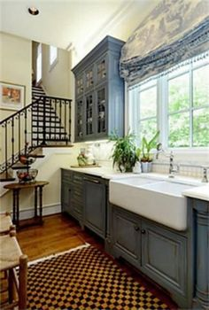 Federal blue cabinets seem neutral in this home with Spanish-style iron stair rail and airy high ceilings Farmhouse Kitchen Cabinets, Kitchen Redo, Kitchen Remodel, Kitchen Design, Kitchen Ideas, Stairs Kitchen, Open Kitchen, Kitchen Interior, Blue Cabinets