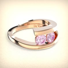 Pretty in pink. Talinn diamond engagement ring with two pink created lab-diamonds and pink ethical gold. From the #DeVindt contemporary collection.