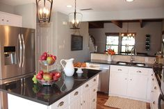 HGTV Fixer Upper - white cabinets opening to living space. Would love brass or pewter drawer pulls.