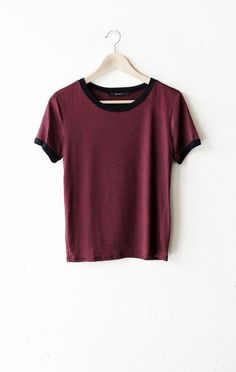 """- Description - Size Guide Details: Short sleeve striped ringer in burgundy/black with black contrast collar & sleeve bands. 50% Polyester, 50% Rayon. Made in USA. Sizing: 33"""" / 83.82 cm full chest 22"""