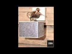 Betaalbare designverlichting gemaakt van afworpgeweien en drijfhout