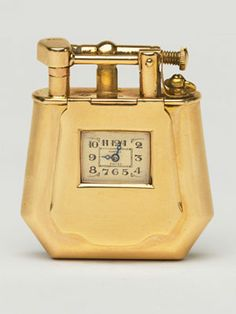 """Rare gold lighter. Both are """"fancy shape"""" watch lighters, 1927, by Dunhill."""