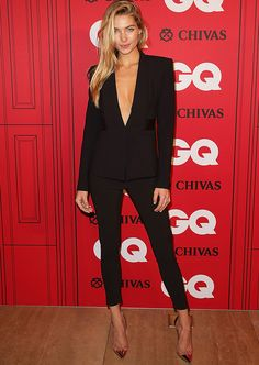 Jessica Hart takes the plunge in this sleek black suit, sans shirt