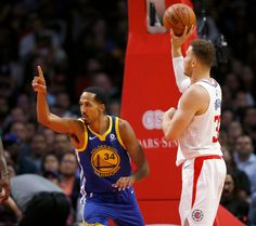 Golden State Warriors guard Shaun Livingston, left, reacts after making a basket as Los Angeles Clippers forward Blake Griffin, right, grabs the basketball during the first half of an NBA basketball game, Monday, Oct. 30, 2017, in Los Angeles. (AP Photo/Ryan Kang)