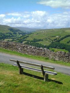 A seat with a view of Upper Swaledale in the #Yorkshire Dales. Summit of Great Shunner Fell on the horizon.