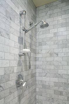 •Marble subway tile  Shower bar  •Handheld shower bar