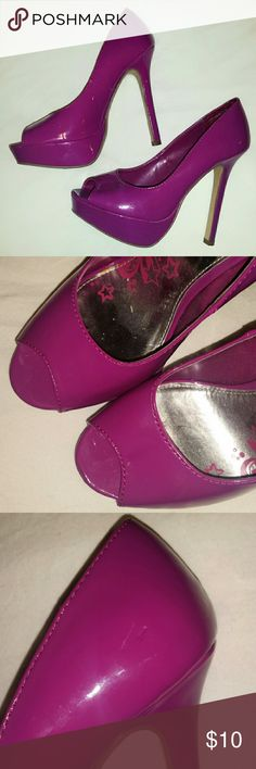 Brash Purple Patent Platform Pumps ....now say that 5 times fast! These heels are a beautiful shade of purple and are in excellent used condition, the only noteworthy flaw is a scratch on the heel of the right shoe, facing inward so it's not very noticeable. Heel is 5.25 inches tall. Brash Shoes Platforms