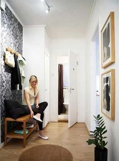 Woman sits on bench, hanging storage above, rug on floor Ikea Hanging Chair, Hanging Storage, Teak Adirondack Chairs, Ikea Bench, Hall Bench, Bold Wallpaper, Hallway Designs, Cool Chairs, Inspired Homes