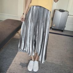 Midi skirt Fashionable Silver pleated skirt. Never worn except to model. Bought at a NYC boutique. Can be dressed up or down. Skirts Midi
