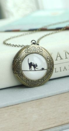 Cat and Mouse Locket Necklace. Round Antiqued Brass Locket Jewelry. Black Cat Locket.https://www.etsy.com/listing/206106327/cat-and-mouse-locket-necklace-round?ref=shop_home_active_6