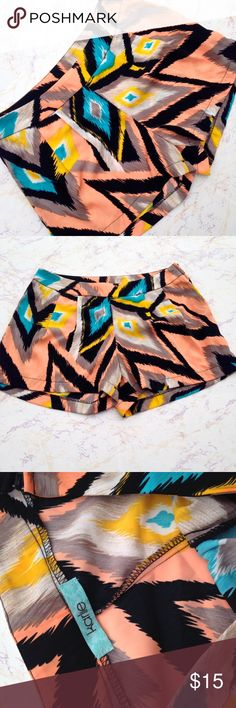 Size Medium Abstract Short Shorts Very lightweight thin and airy. Size medium. Cute colorful abstract print. Peach, turquoise, tan, black. Zips on the side. Karlie Shorts