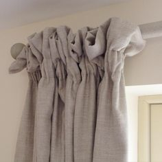 Interlined curtains in plain Scottish linen with a soft country heading, hung from a beautiful pole by Acanthus Vintage