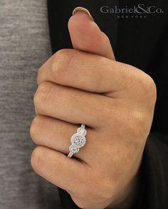 Three Stone Halo Style. Round Cut Diamond Center. White Gold Engagement Ring. Style #: ER913028