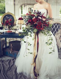 Love this - blue dress though, less greenery in bouquet and not so big table decor. But overall this looks amazing
