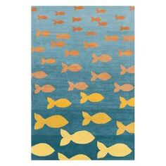 Hand-tufted wool rug with a multicolor goldfish motif and cotton backing.   Product: RugConstruction Material: 100% WoolColor: MultiFeatures:  Hand-tufted  Cotton backing Dimensions: 5' x 7'6Note: Please be aware that actual colors may vary from those shown on your screen. Accent rugs may also not show the entire pattern that the corresponding area rugs have.Cleaning and Care: Professional cleaning is recommended