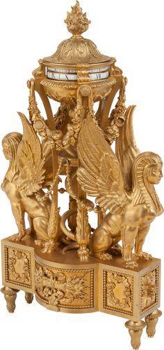 A Napoleon III Gilt Bronze Figural Sphinx Revolving Clock, 19th century.