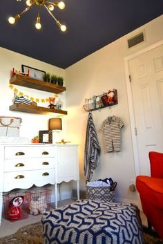 Modern Nursery with Woodland accents featuring a bold navy ceiling. LOVE!