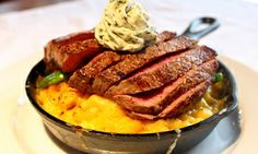 Groupon - $ 12.99 for $24 Worth of Gastropub Dinner and Drinks at G's Midtown  in Piedmont Park. Groupon deal price: $12.99