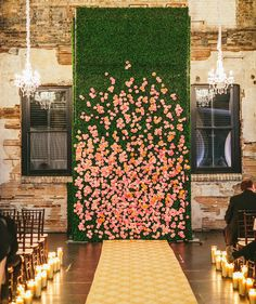 Flower Backdrop | 20 Unexpected Wedding Flower Ideas | https://www.theknot.com/content/unique-wedding-flower-ideas
