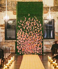 Flower Backdrop | 20 Unexpected Wedding Flower Ideas | https://www.theknot.com/content/unique-wedding-flower-ideas