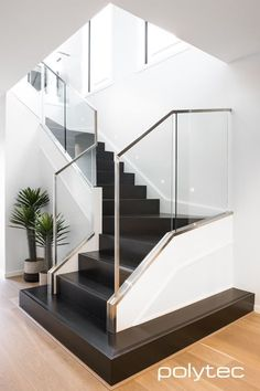 Stylish modern stairs in Black Valchromat finished with a clear coat Stairs Design Modern Black clear coat finished Modern Stairs Stylish Valchromat Home Interior Design, Staircase Decor, Stairs Design, Stairs Design Modern, Home, House Staircase, Modern Stairs, House Stairs, Home Stairs Design