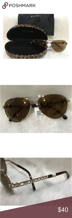c48a355600a9 Shop Women s Guess size OS Sunglasses at a discounted price at Poshmark.  Comes with case and cleaning cloth. Goldtone chain accent on arms.