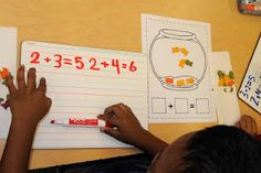 Use goldfish as manipulatives to show addition problems after reading One Fish, Two Fish