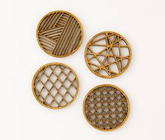 Set of 4 bamboo coasters. Each measure approx. 3.5 inches diameter, and 1/4 inch thick. Each design is based off an original geometrical hand-cut