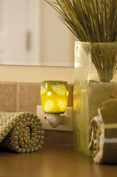 Grotto plug-in. Looks beautiful in any room. Check out the different styles. Scents such as French Lavender or Mediteranean spa will make any bathroom feel like a spa.