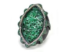 """Wendy Yue's ring is made in wood and jade with colored sapphires and brown diamonds ($9,855).    """"Something that's been a trend for a long time and that was seen at Vegas this year and kicked off by the recession is the use of non-precious materials with precious materials,"""" O'Connor says, """"and I think that is something that is becoming mainstream."""""""