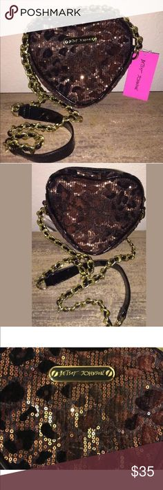 New Betsey Johnson Leo Crossbody Purse Bag Leopard Brand new with tags Betsey Johnson crossbody heart bag. Sparkly bronze sequins all over with zipper top and gold chain with faux leather running throughout it. Originally purchased at Macy's. 2 small pockets inside purse. Betsey Johnson Bags Crossbody Bags