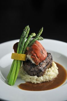 Grilled Filet Mignon with Half Butter Poached New England Lobster Tail With a Red Wine Demi-Glace roasted corn risotto and sautéed cherry tomatoes and snap beans plantationcaterin. Gourmet Recipes, Beef Recipes, Dinner Recipes, Cooking Recipes, Food Plating Techniques, Food Presentation, Food Design, Food Inspiration, Food Photography