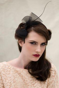 A lovely little bow fascinator, made using a black hand curled feather quill and crin, attaches with a gold coloured metal headband.    • Made