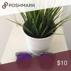 Large grey rim sunglasses Large sunglasses with grey marble color rim. Purple/blue reflective lenses. Plastic. Accessories Sunglasses