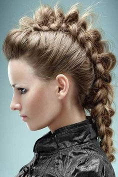 Mohawk Braid - from looking at it, it looks like a tiny poof followed by a tight reverse french braid, which you then pull apart to suit.