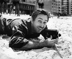 Walt Disney with an 8mm movie camera. Copacabana Beach, Rio de Janeiro, Brazil, 1941.