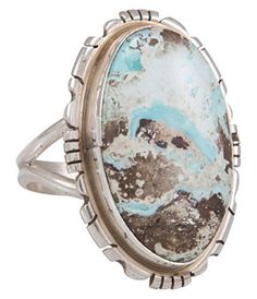 This is a Navajo handcrafted ring size 7 1/4 by Scott Skeets. This ring is created with Dry Creek Mine Turquoise crafted with Sterling Silver. This piece is signed by Scott noted as S Skeets and is stamped Sterling. The face of the ring is 1 in...