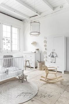 Stunning white nursery with storage ideas.