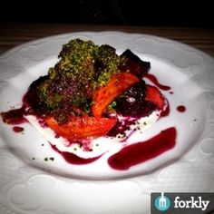 Roasted Beets, Green Curry, Broccoli, Goat Blue Cheese, & Beet Top Bread Crumbles at Lenoir Austin in Austin