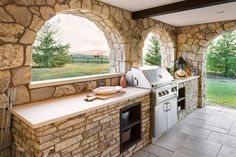 Lynn Donaldson & Associates // Exterior // Deck // Stone Arches // Outdoor Fireplace // Outdoor Living // Outdoor Dining