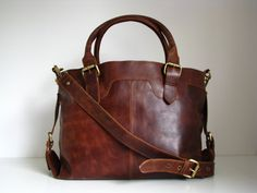 A vintage inspired large leather tote which would work well as a work bag - also perfect for mums who need lots of carry space. bag. Made from