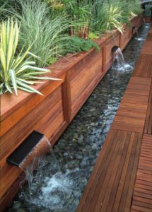 Water feature, raised bed and decking.