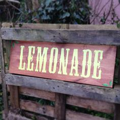Hand painted lemonade sign. We thought this would look fab at a rustic country summer event. This is for the hire of the sign only to allow you to experiment with making your own stand to serve lemonade from. We have used old tea chests with a wooden door balanced across or barrels with a plank across, or the sign looks perfect perched on this old pallet (pallet not included, sorry!).