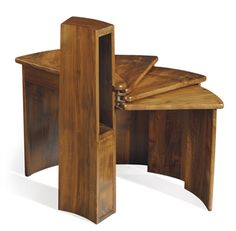 PIERRE CHAREAU (1883-1950)  'MB106' A Walnut Folding Side Table, 1930s. I can only hope, that I'd have been of age near this guys time, that I would have beaten him to this geometric designing.