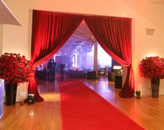 red carpet entrance; rep draping; red rose columns